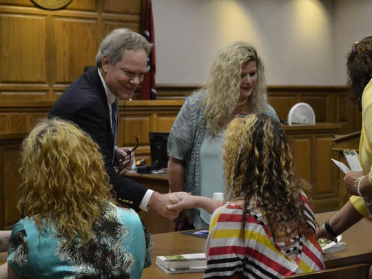 Judge Don Allen, left, greets Life's Healing Choices graduate Bliss McEarl as Life's Healing Choices teacher Rae Lynn Barahona, back right, talks with program director Katherine Cothern, right, on Friday at Life's Healing Choices graduation.