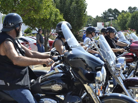 Motorcyclists wait to take off for the Poker Run at Serra of Jackson on Saturday.