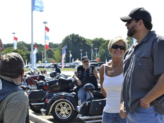 Riders Carla and Michael Harper, right, talk with other supporters before the poker run Saturday at Serra of Jackson.