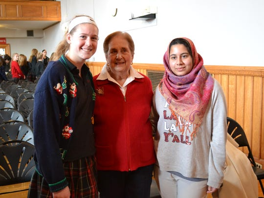 At Ursuline, Lindsay Brown, Ann Jaffe and Areeba Khan gathered after Jaffe shared her story of survival during the Holocaust.
