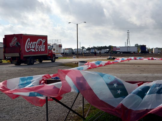 High winds blow the skirting around the stage at the Rapides Parish fair grounds as vendors pack up their areas on Monday, October, 13, 2014. --Tia Owens-Powers/ towens@thetowntalk.com