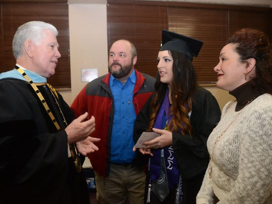 Outgoing NSU President Randall Webb (left) speaks with student Abigail Bass (center) and her parents, Jeff Bass (second from left) and Kristi Bass (far right), Friday, Dec. 19, 2014 before the NSU commencement ceremony.