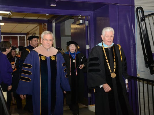 ANI NSU graduation Incoming NSU president James Henderson (left) and outgoing NSU president Randall Webb begin the commencement ceremony Friday, Dec. 19, 2014.-Melinda Martinez/mmartinez@thetowntalk.com The Town Talk, Gannett