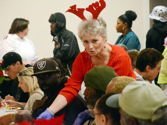 Sally Allen of Jena serves Christmas dinner Thursday to people at the Salvation Army shelter.