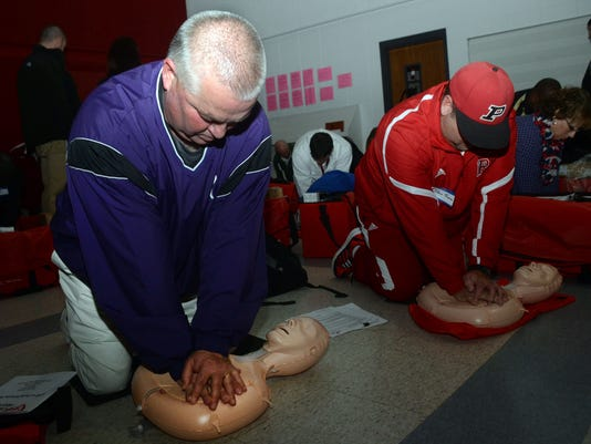 ANI Hands over Heart Training Glenn Granger (left) of Rosepine High School and Eddie Thomas of Pickering High School take a CPR training course sponsored by Hands Over Heart Tuesday, Jan. 6, 2015 at Tioga High School. Area teachers, coaches and principals