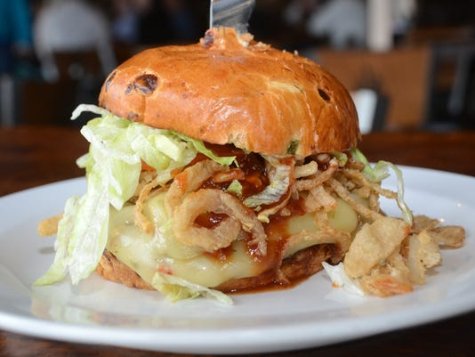 ANI Spirits Burger Knob Creek Smoked Maple BBQ Burger served by Spirits Food & Friends in Alexandria is topped with pepperjack, jalapeños, BBQ sauce, fried onion strings, chipotle mayo, lettuce and tomato. Saturday, Jan. 10, 2015.-Melinda Martinez/mmartin