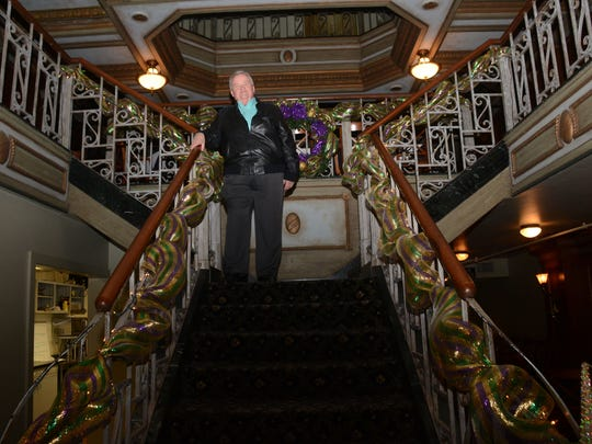 Mike Jenkins stands on the ornate staircase of the Diamond Grill Restaurant in downtown Alexandria.