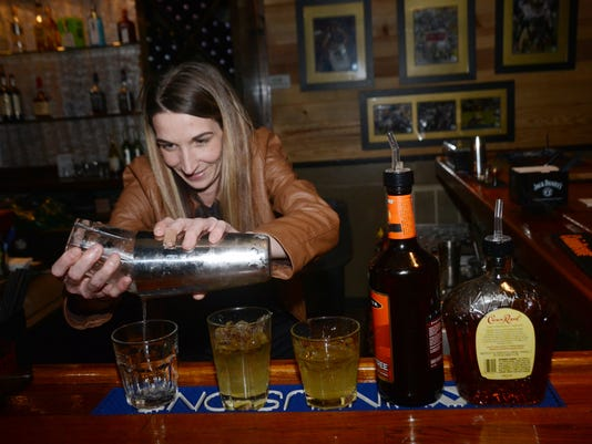 ANI Poppa T's Oyster House and Grill Nikki White, a bartender at Poppa T's Oyster House and Grill on Highway 28 East in Pineville, mixes up some drinks Friday, Jan. 30, 2015.-Melinda Martinez/mmartinez@thetowntalk.com The Town Talk Gannett