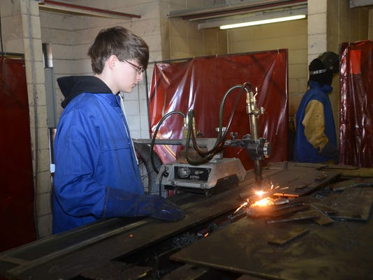 ANI Jump Start Career Diplomas Tioga High School ninth grader Kaleb Mitchell cuts metal with a torch in welding class Wednesday, Feb. 6, 2015.-Melinda Martinez mmartinez@thetowntalk.com The Town Talk Gannett