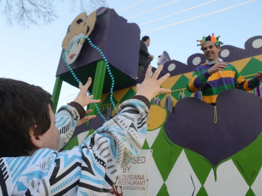 ANI Children's Parade Aiden Burke catches beads from a passing float at the Alexandria Children's Mardi Gras Parade held Saturday, Feb. 14, 2015 in downtown Alexandria.-Melinda Martinez/mmartinez@thetowntalk.com