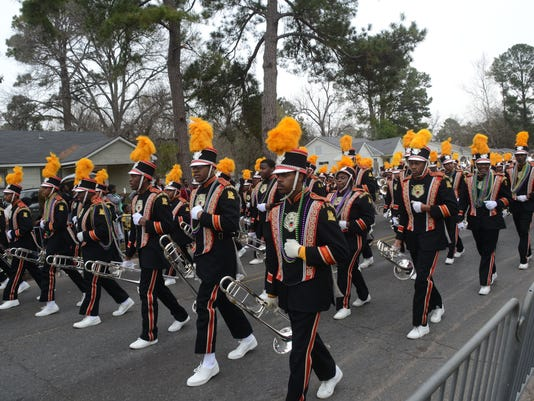 ANI Alex Mardi Gras Parade The Grambling State University marching band entertains the crowd at the Alexandria Krewe Mardi Gras Parade Sunday, Feb. 15, 2015. The band participates in the parade every year.-Melinda Martinez/mmartinez@thetowntalk.com The Tow