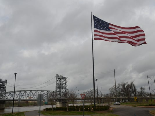 ANI 304 Wild Art The flag along the Red River levee in Pineville whips in the wind Wednesday, March 3, 2015.-Melinda Martinez/mmartinez@thetowntalk.com The Town Talk Gannett