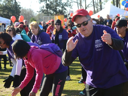 Dale Villemarette, cath lab manager at Christus St. Frances Cabrini Hospital, and other Cabrini associates, dance during the 2015 American Heart Associatiom Heart Walk held Saturday, March 7, 2015.