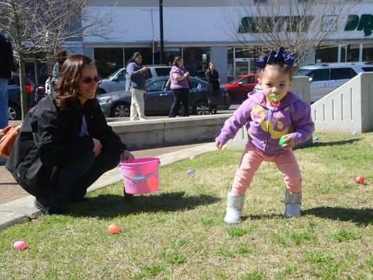 Stepanie Clark (left) watches granddaughter Mariah Tutson, 20 months, as she hunts for Easter eggs. The YWCA hosted a Breakfast with the Bunny event at The Gem in downtown Alexandria on Saturday. The event included an Easter egg hunt, a ride on Choo-Choo Alex and a McDonald's breakfast with the Easter Bunny. Proceeds from the event benefit the YWCA programs.