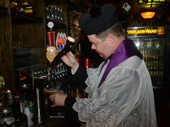 ANI Blessing of the Beer After blessing the beer taps at Finnegan's Wake in downtown Alexandria Tuesday, March 17, 2015, Father Chad Partain pours a glass for himself.-Melinda Martinez/mmartinez@thetowntalk.com