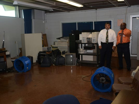 ANI Flooding Aftermath Roy Rachal (left), risk management for the Rapides Parish School District, and Clyde Washington, deputy assistant superintendent, look over one of the classrooms at Arthur F. Middle School which was flooded during Thursday's storm.-M