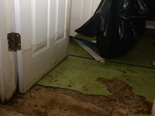 The bedroom door in James and Chrystal Green's house, located on Roanoke Street off Prescott Road in Alexandria, is marked by a water line. Many residents of houses located in neighborhoods off Prescott Road were cleaning up from flooding and trying to salvage belongings.