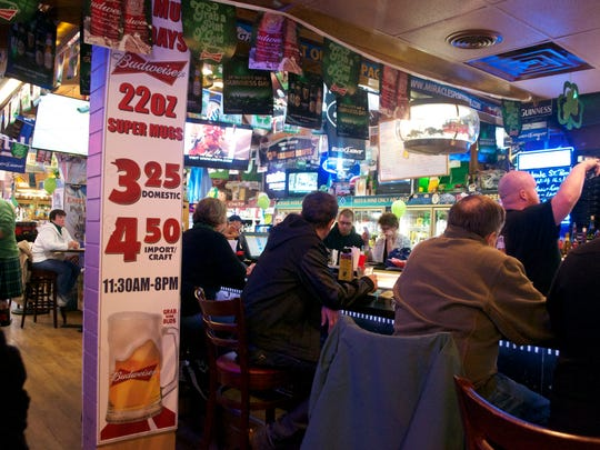 Miracle Pub's walls are decked out in memorabilia that owner Mike Browner has collected over the years. The pub offers daily specials and happy hours.
