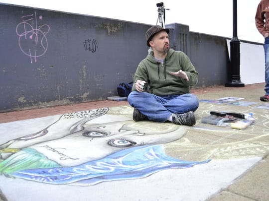 Eric Maruscak, an illustrator and cartoonist who has worked with Lucasfilm, describing a chalk cartoon at Mural Fest 2015.