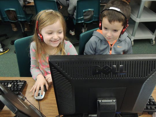 """Warren Township schools participated in Hour of Code, along with thousands of schools throughout the world, during the week of Dec. 8. Students in all grades had the opportunity to learn programming skills and language as they completed activities during either computer classes or innovation and design classes. """"No matter what career students will pursue in the future, knowledge of computer programming and technology will be an integral part of their success,"""" said Jill Zimmer, Central School's REACH teacher. """"Early exposure to these concepts will demystify computer programming, engage students, and propel them to want to learn more."""" Pictured working in the computer lab at Angelo L. Tomaso school are Peyton Kalfus (left) and Taylor Brezee (right)."""
