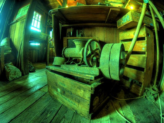 The original fixtures and equipment, such as this grinder, remain at the Ted Smallwood's Store Museum.