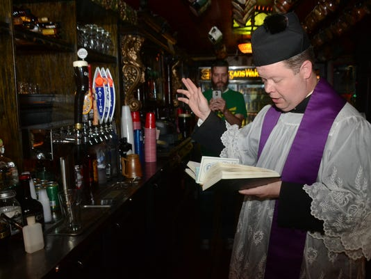 ANI Blessing of the Beer Father Chad Partain says a blessing over the beer taps at Finnegan's Wake in downtown Alexandria Tuesday, March 17, 2015.-Melinda Martinez/mmartinez@thetowntalk.com