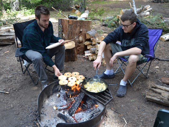 Tyler Dodds and Stefan O'Neill make breakfast over the fire at Mazama Campgrounds near Crater Lake National Park in 2014.