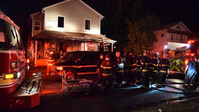 Seven people escaped a fire that broke out early Wednesday at a home on North Hamilton Avenue