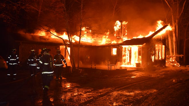 It took firefighters about two hours to battle a blaze that destroyed a north-side home early Monday.