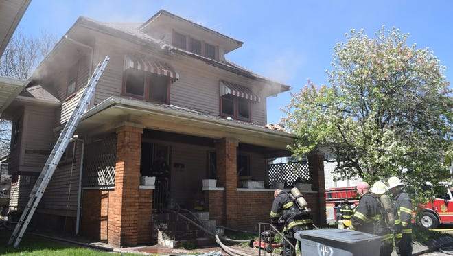 A 90-year-old woman died Friday afternoon, after being carried out of an east-side Indianapolis home that caught fire.