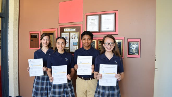 (From left) Madeline Fawcett, Tabitha Gentiletti, Shivam Sachdeva and Gabrielle Sangataldo, eighth-graders at St. Mary School, received the National Junior Honor Society Outstanding Achievement Award.