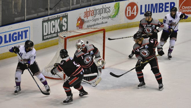 Mark Pustin completes a hat trick in the second period of the Ice Bears' 7-3 win over Huntsville on Friday night at Civic Coliseum.