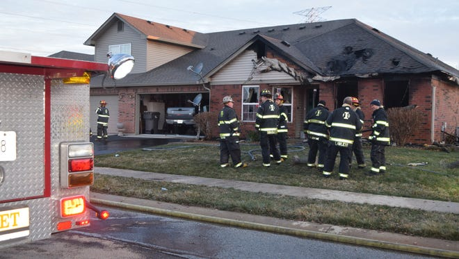 Indianapolis firefighters put out an early-morning fire in a condo unit in the Carriage Courts neighborhood on Timber Lake Boulevard on Saturday, March 11, 2017.