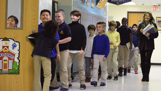 Mrs. Earhart (right) and her fourth grade class return to their classroom at the Park Avenue School in Freehold in this December 2016 file photo.
