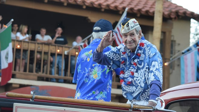 Leo Priest waves to parade attendees during the 2016 Veterans Day Parade in downtown Palm Springs.