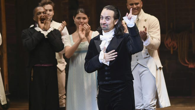 "FILE - In this July 9, 2016 file photo, ""Hamilton"" creator Lin-Manuel Miranda, foreground, gestures during his final performance curtain call in New York. Miranda, who was everywhere in popular culture this year, was named The Associated Press Entertainer of the Year, voted by members of the news cooperative. (Photo by Evan Agostini/Invision/AP, File)"