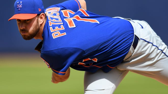 Mets pitcher David Peterson throws against the Washington Nationals at FITTEAM Ballpark of the Palm Beaches.