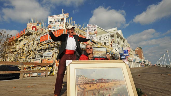 """Jo Kroart, owner of Ocean Gallery, and Hunter """"Bunk"""" Mann join forces to sell Mann's book, """"Vanishing Ocean City,"""" during a recent book signing on the Ocean City Boardwalk."""