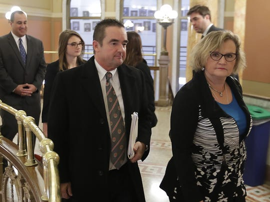 Green Bay Mayor Jim Schmitt enters the Brown County Courthouse on Monday for his sentencing on three misdemeanor counts of violating state campaign finance law.