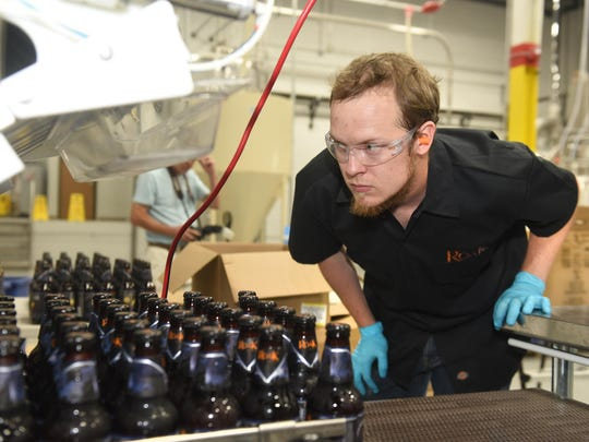 John Hackett oversees the bottling process at ROAK Brewing Company in Royal Oak. The facility includes brewing, an outdoor area and a 70-seat tap room.