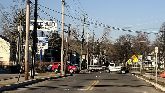 Elmira police sealed off the area around the intersection of South Main and Mount Zoar streets Tuesday morning after responding to a call about a fight and finding a body.