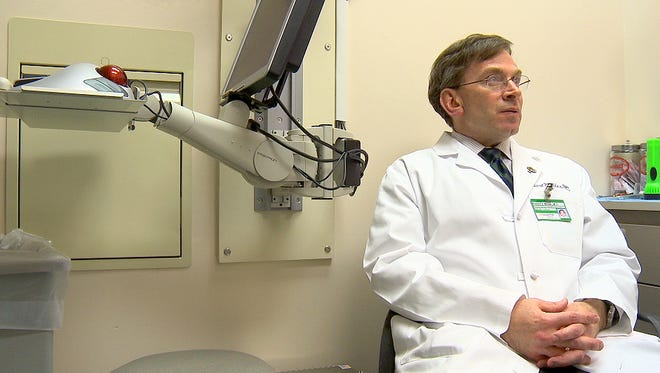 Dr. Robert Miller sits in an exam room at Vanderbilt University Hospital. Miller believes high rates of respiratory and neurological ailments among U.S. troops are a result of the inhalation of microscopic dust particles in Iraq, which have been found to be laden with toxic metals, bacteria and fungi.