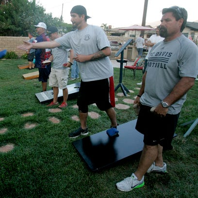 Competitors hope to bag some cash at Spencer Makenzie's cornhole tournament