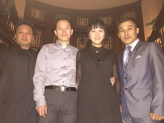 From left, Izakaya executive chef Minh Nguyen, owners Shon and Dana Lin and general manager John Lee at the restaurant's VIP opening party.