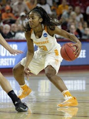 Tennessee guard Te'a Cooper (20) drives against Green