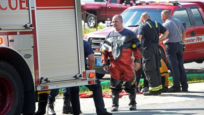 Worcester firefighters regroup after pulling a man out of Lake Quinsigmond on Wednesday. The man was found very quickly and was taken to UMass Medical Center - University Campus.