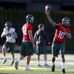 Ty Griffin (10) is one of five quarterbacks fighting for Marcus Mariota's position on the football team. He practices with teammates at the Hatfield-Dowlin outdoor fields on Tuesday, March 31, 2015 in Eugene, Ore.