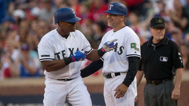 Rangers third baseman Adrian Beltre celebrates hitting a single during the first inning against the Rays at Globe Life Park in Arlington.