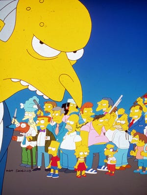 """Montgomery Burns, foreground, appears with other animated cast members in a scene from Fox Television's """"The Simpsons."""""""
