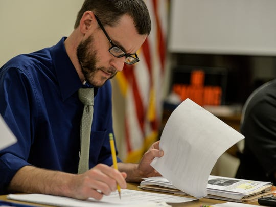 Nicholas Yingst, Township Administrator for Annville Township takes notes during the Annville Township Authority meeting on Tuesday, November 24, 2015.